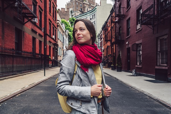 Young attractive Russian girl walking all alone on the street in New York