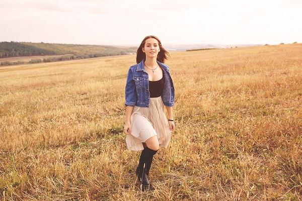 Beautiful sexy Russian girl enjoy wild nature walking outdoors while wearing a white skirt