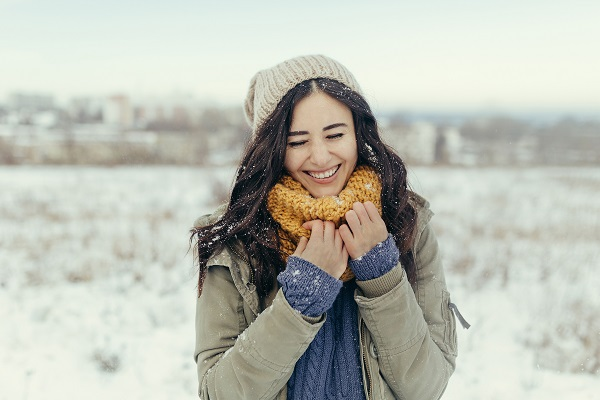Attractive young Russian woman is spending her wintertime walking outdoors all alone