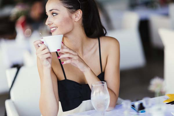 Beautiful women drinking tea in restaurant